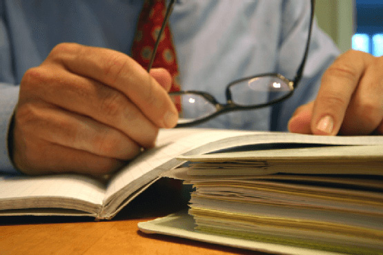 close-up of lawyer going over papers